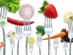 lots of forks with different types of vegetables